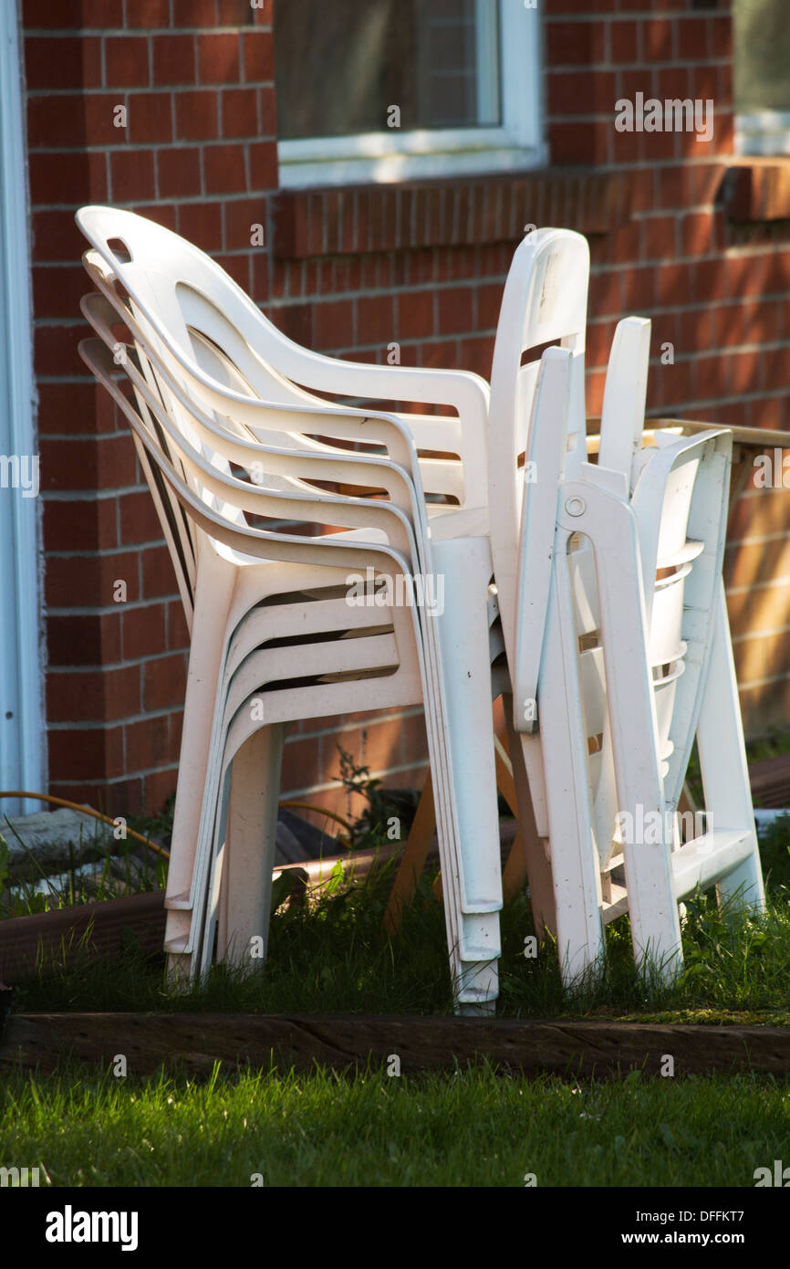 https www alamy com stack of plastic lawn patio chairs image61195799 html