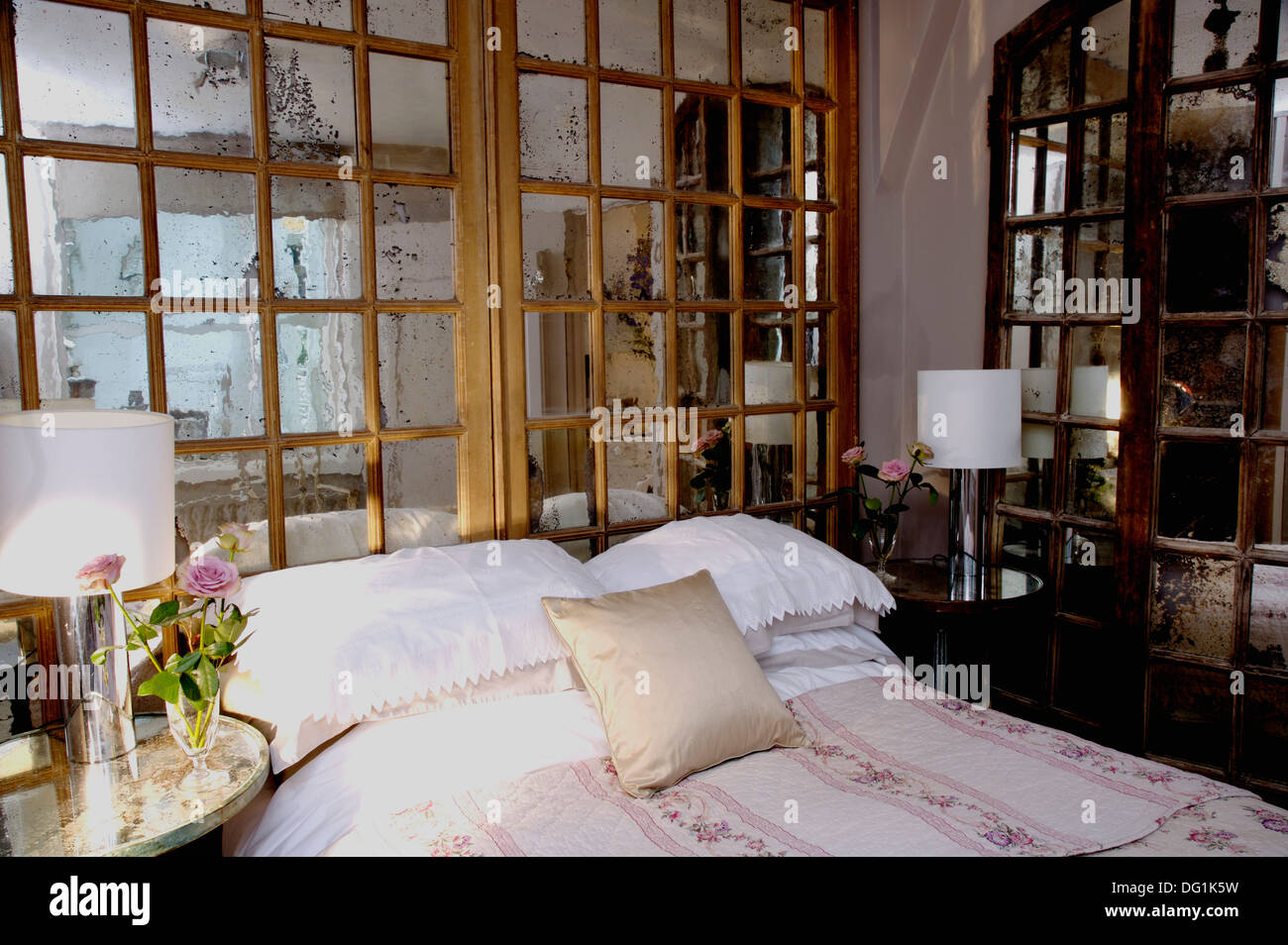 Mirrored Window Frame Doors On Wall Behind Bed With White