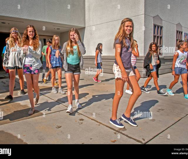 Mission Viejo Ca Middle School Teen Girl Students Walk Out Of The School Building During Outdoor Recess