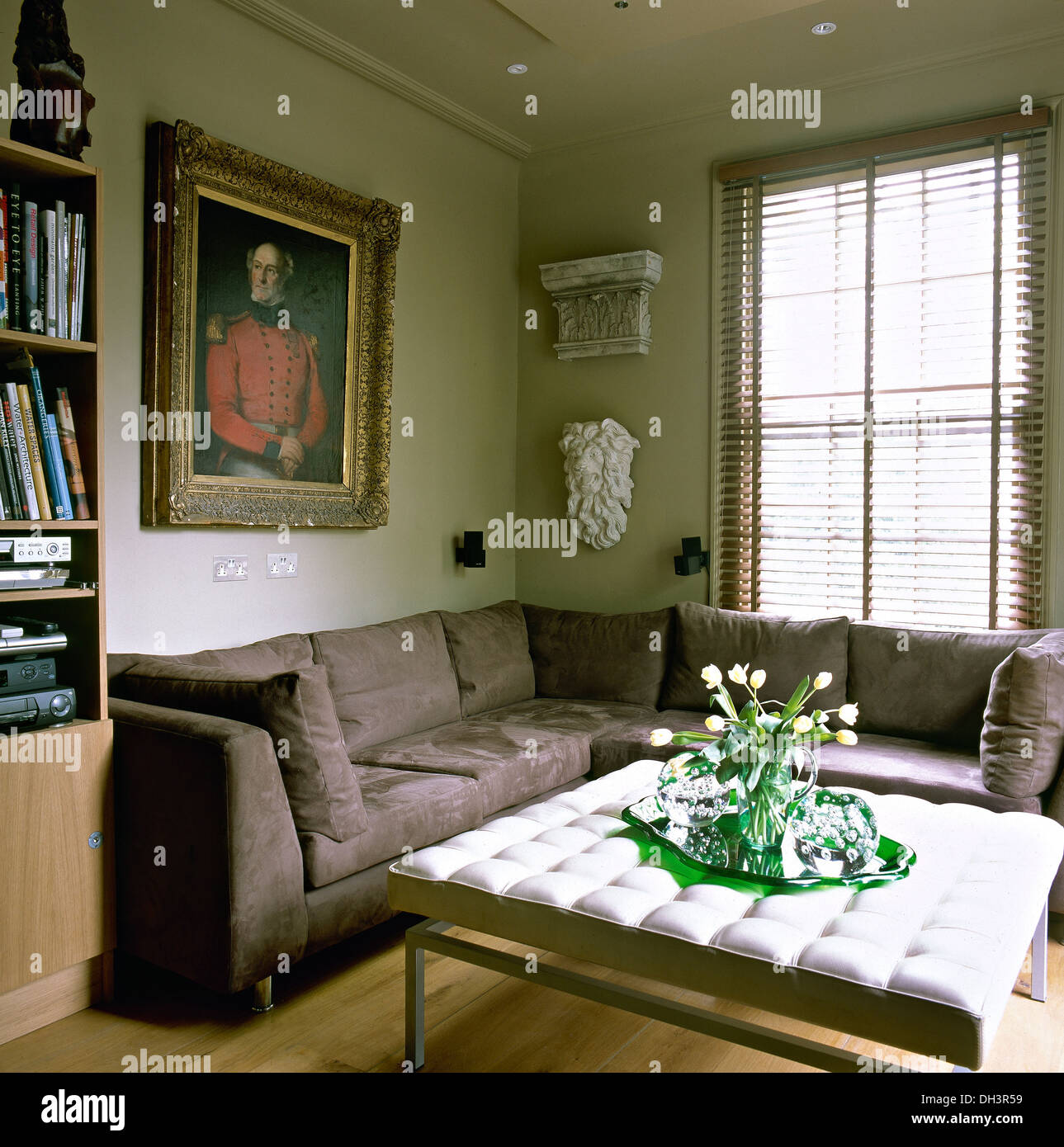 https www alamy com large portrait painting above brown suede corner sofa in living room image62164293 html