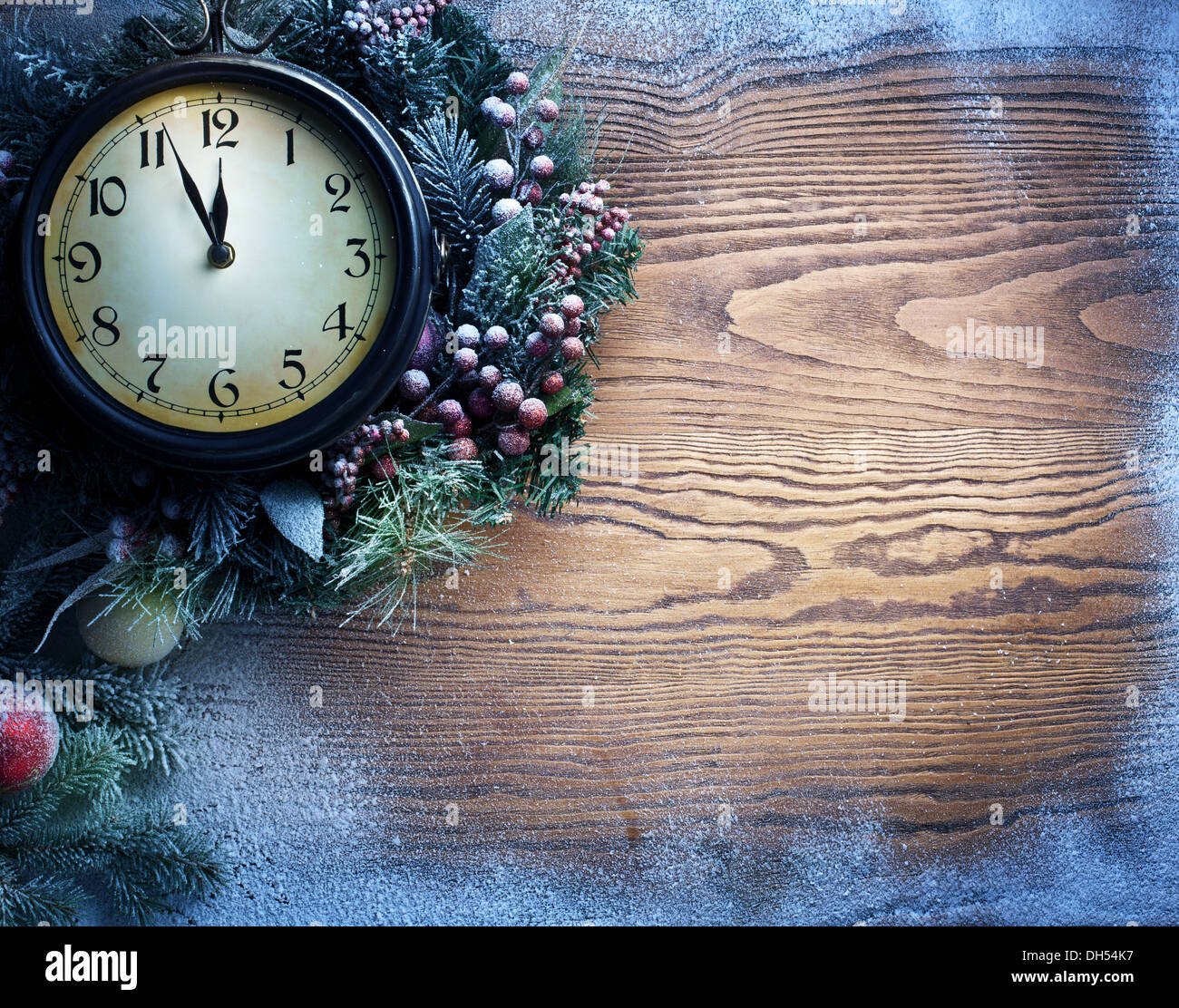 New Year clock over snow wooden background  Five to twelve Stock     New Year clock over snow wooden background  Five to twelve