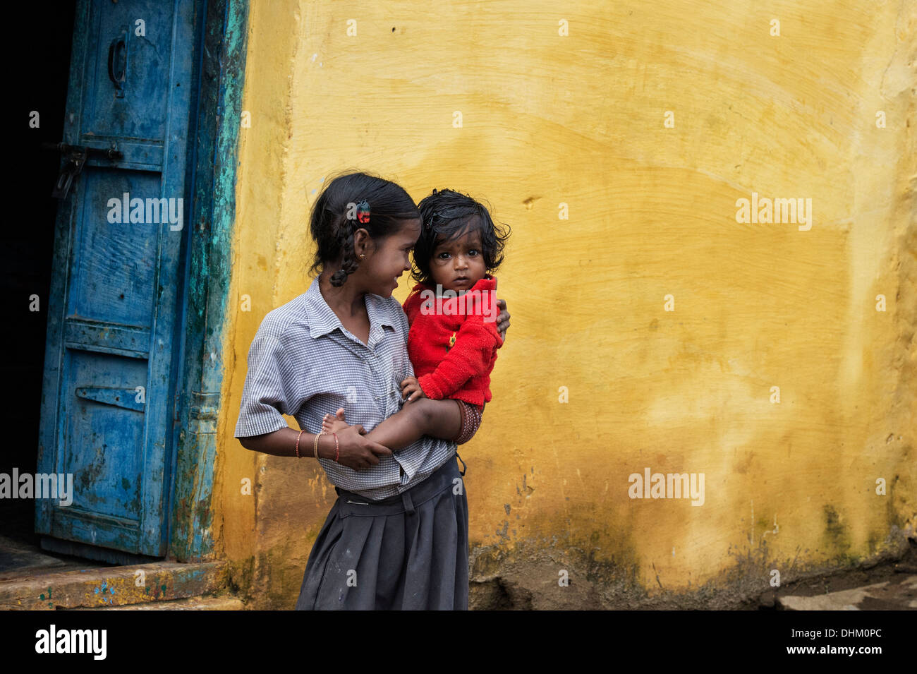 Image result for indian girl holding baby