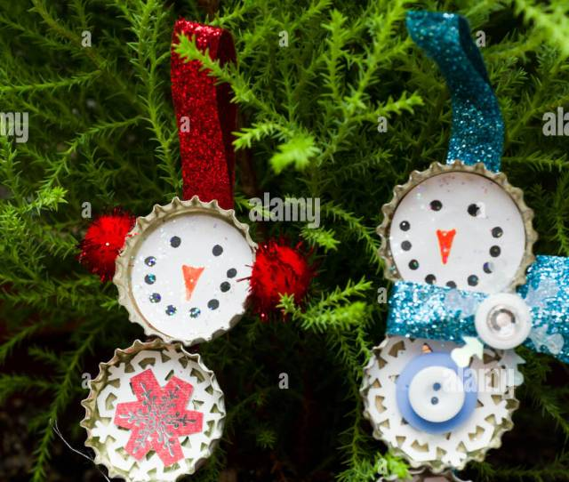 Hand Made Christmas Ornaments Next To A Small Pine Tree