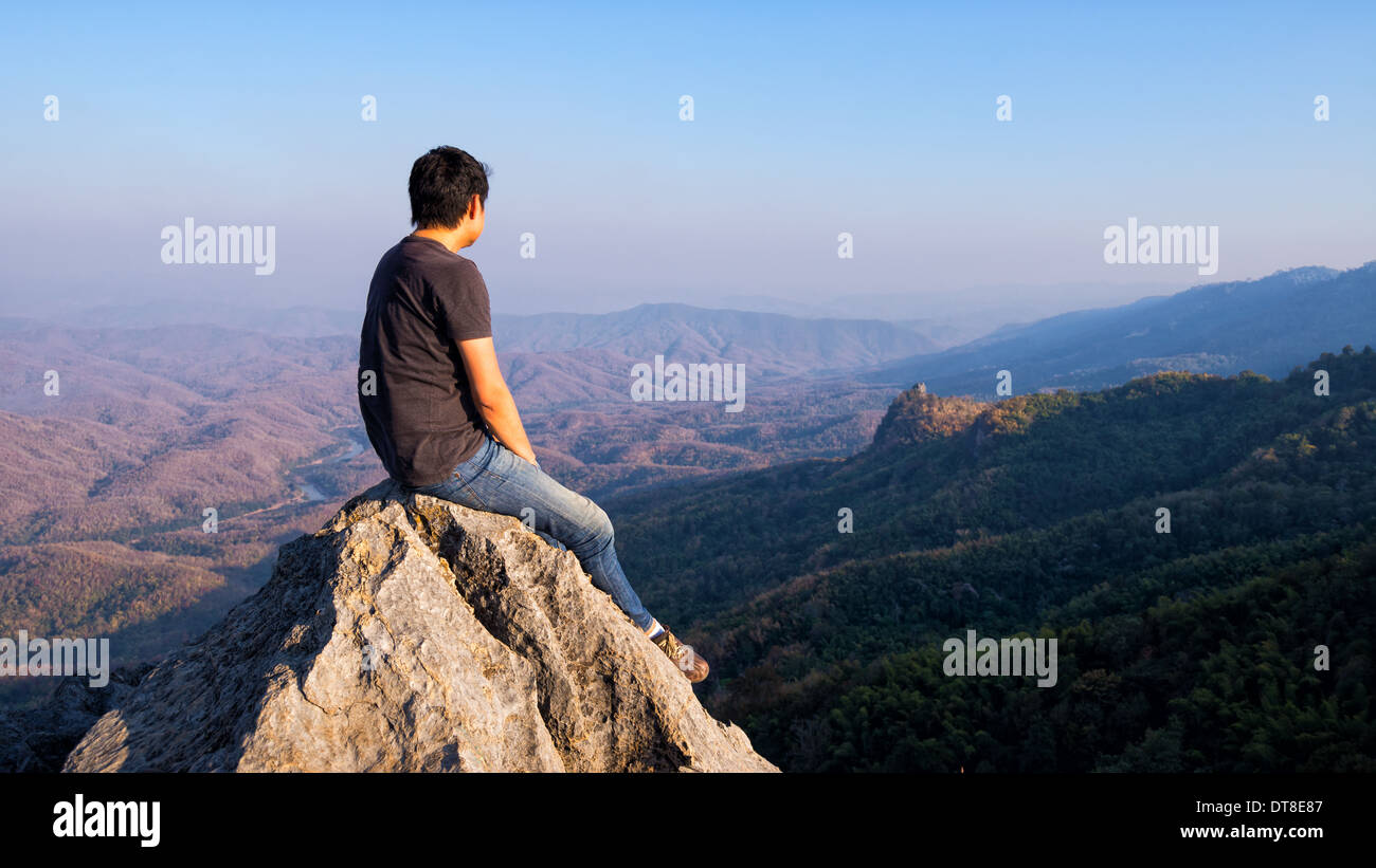 Image result for picture of a man sitting on top of a mountain