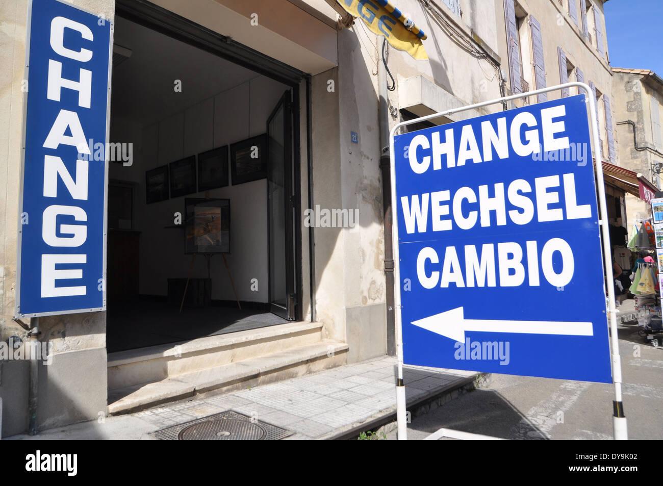 a pavement sidewalk sign outside a bureau de change in arles france