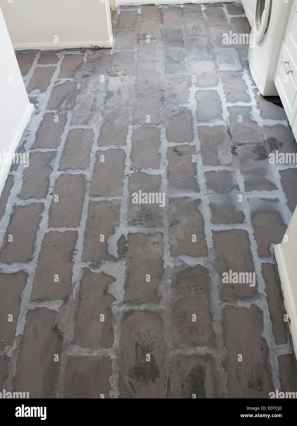 https www alamy com bad diy bad floor tiling job with lots of excess grout grouting between image69378232 html