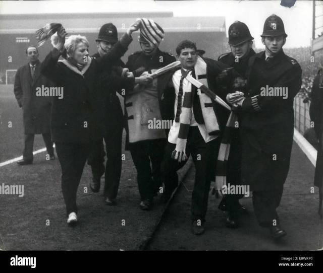 F A Cup Fifth Round Arsenal V Liverpool Today Photo Shows Spectator Is Being Escorted From The Ground By Police Just Before The Start Of The