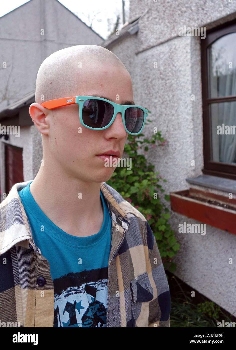 A Teenage Boy With A Skinhead Haircut Stock Photo