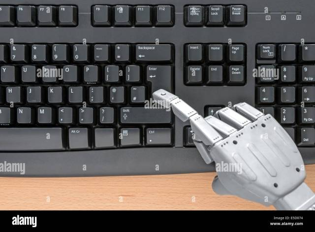 Robot hand typing on a computer keyboard Stock Photo - Alamy