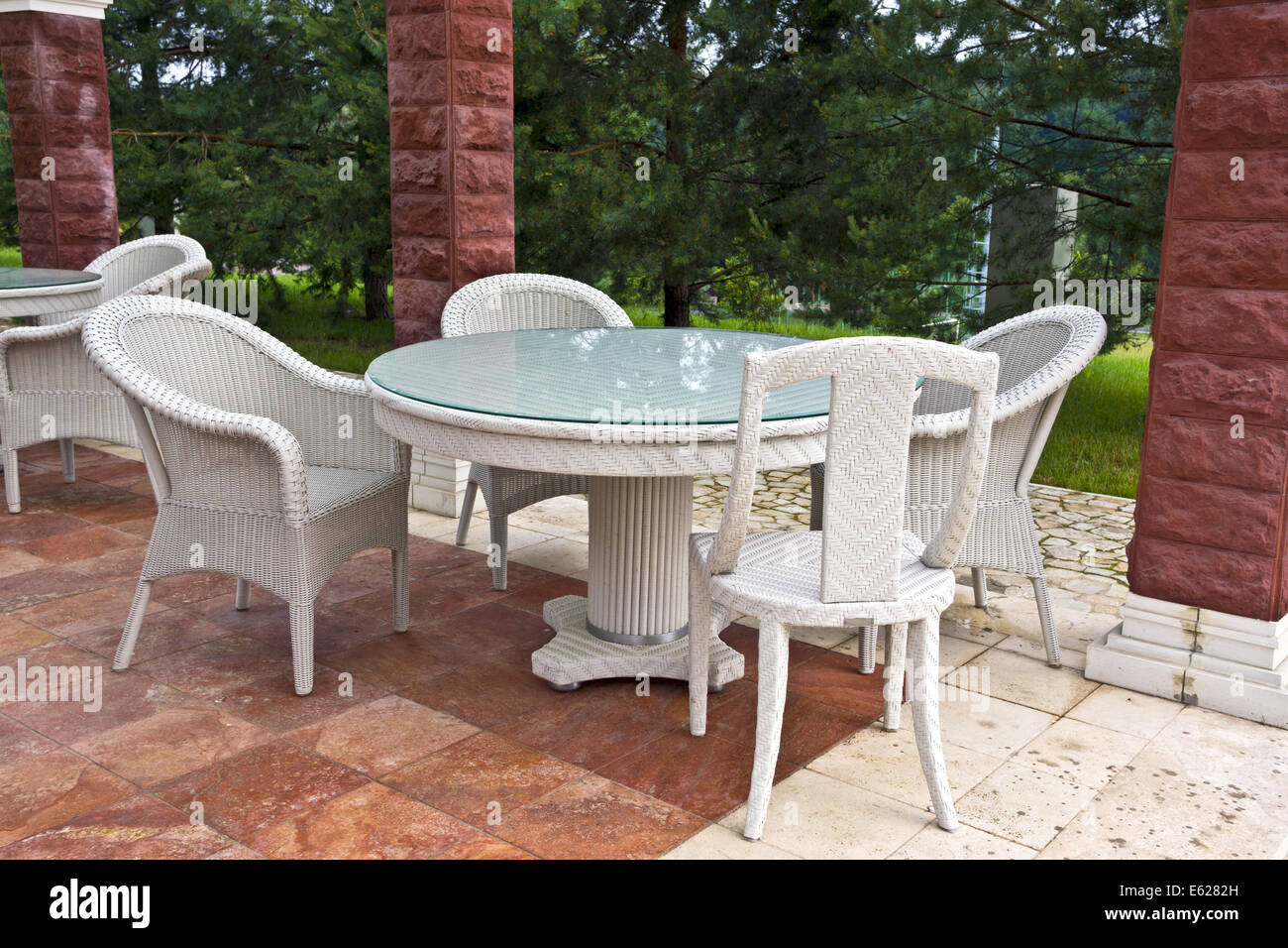 white table and chairs patio furniture in a garden s gazibo stock image