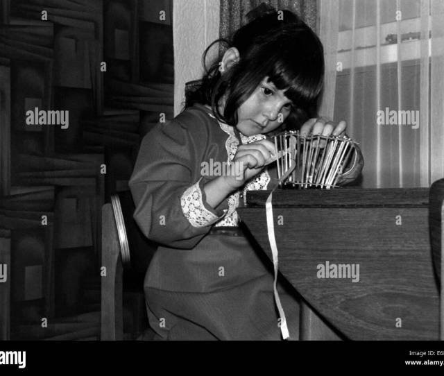 Young Girl Concentrating On Basket Weaving In The 1970s Stock Image
