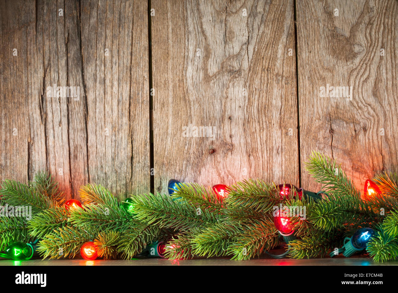 Christmas Tree Branch With Lights On Grunge Wood