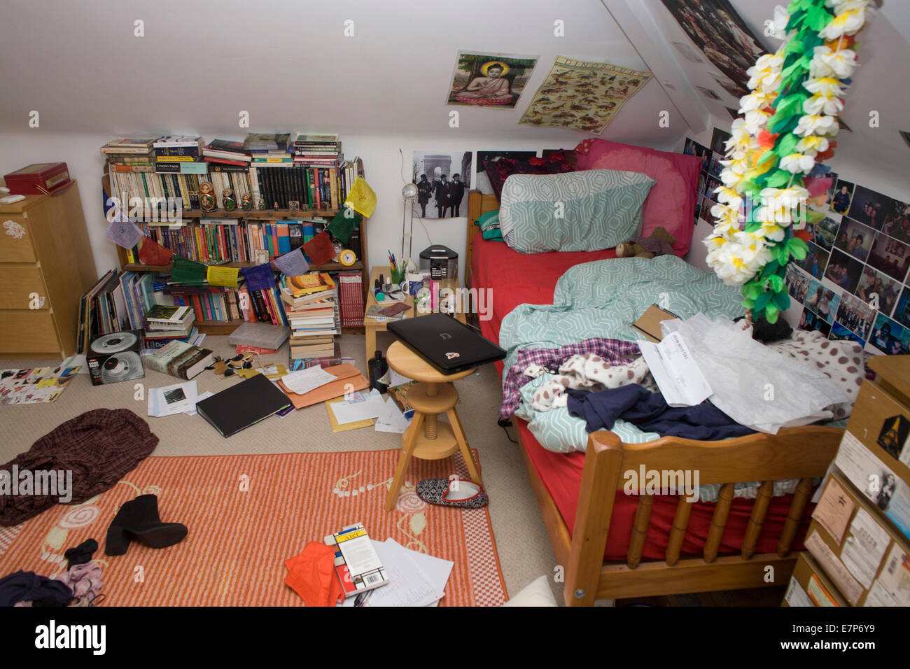 A Teenager S Messy Bedroom With Clothes Books And