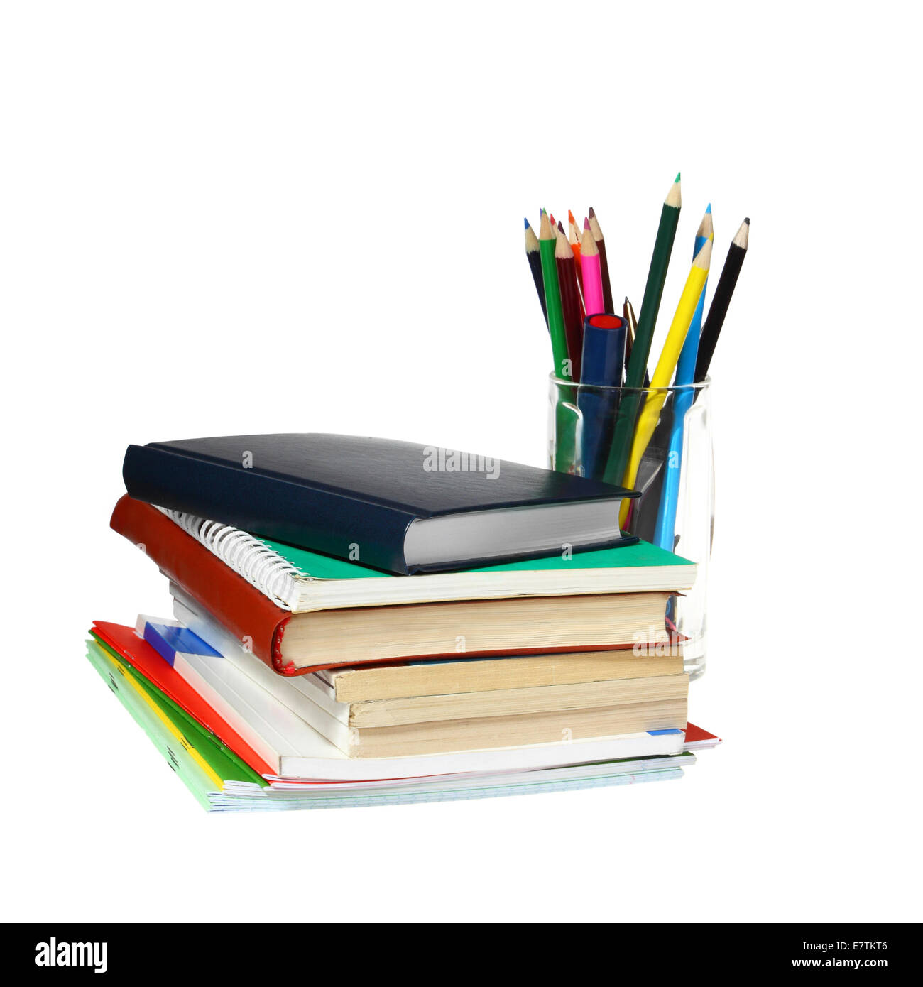 Notebook And Textbooks In Stack And Glass With Pencils