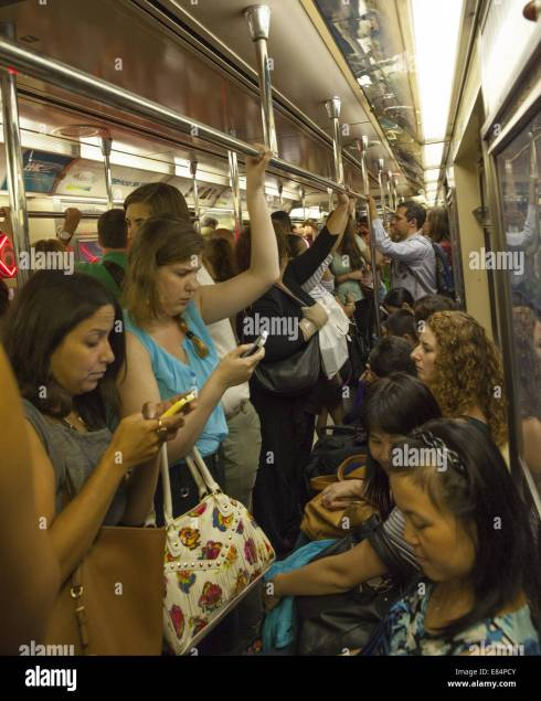 Crowded subway car at the evening rush hour in New York City Stock ...