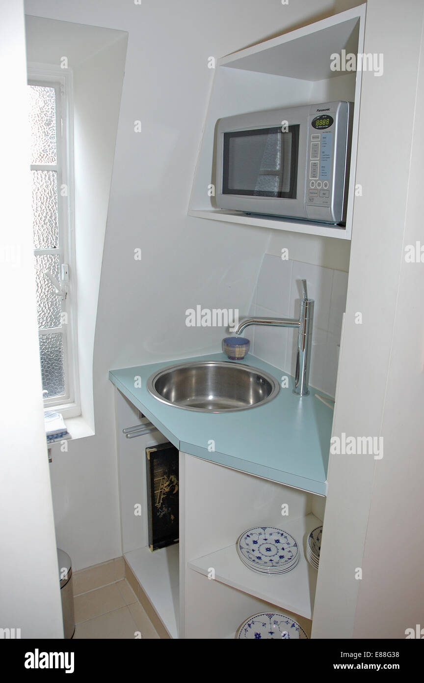 https www alamy com stock photo microwave oven on shelf above built in stainless steel sink in small 73946972 html