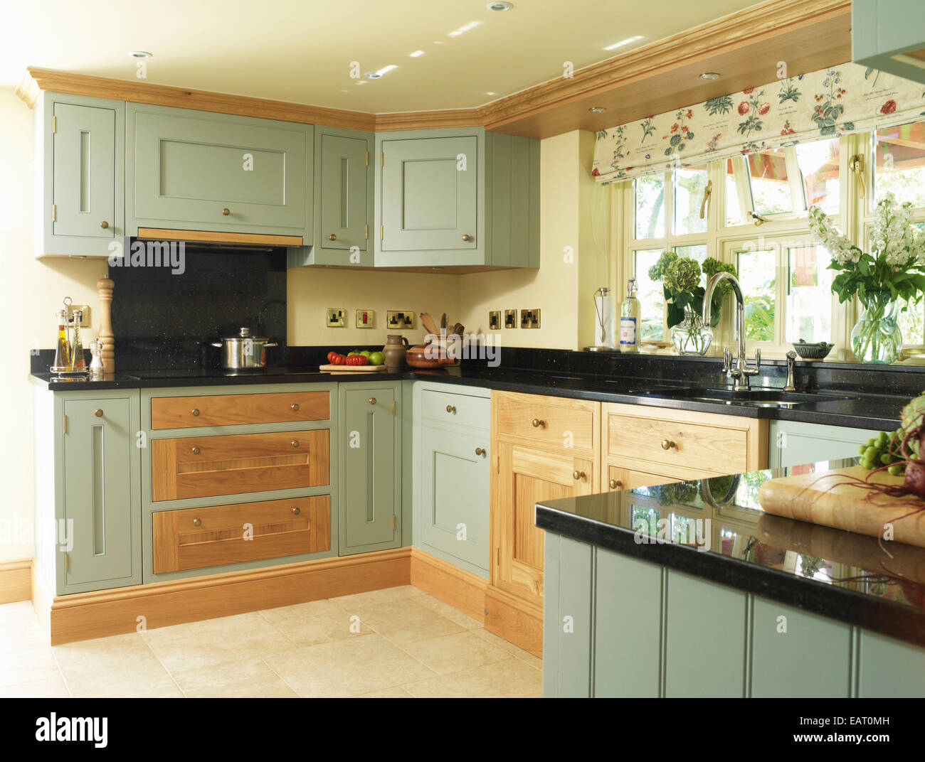 Country Style Kitchen With Green Fitted Units Stock Photo Alamy