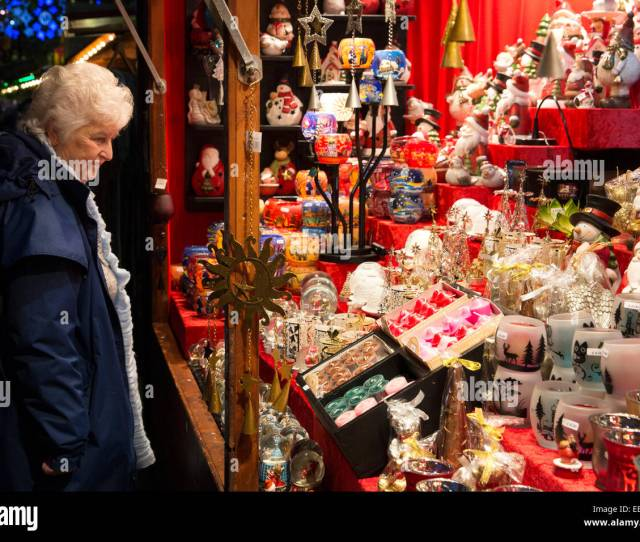 Birmingham Frankfurt German Christmas Market Now In Its Fourteenth Year A Visitor Looking At German Items On A Stall