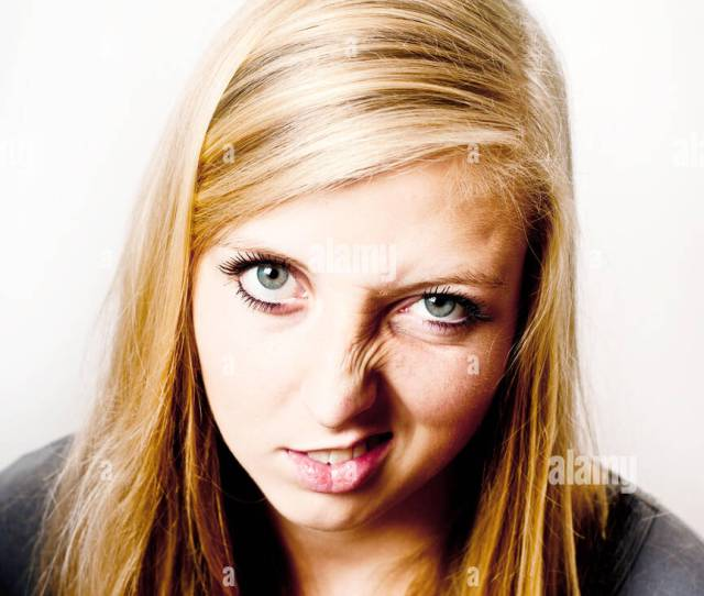 Blond Teenager Girl Making A Funny Disgusted Face