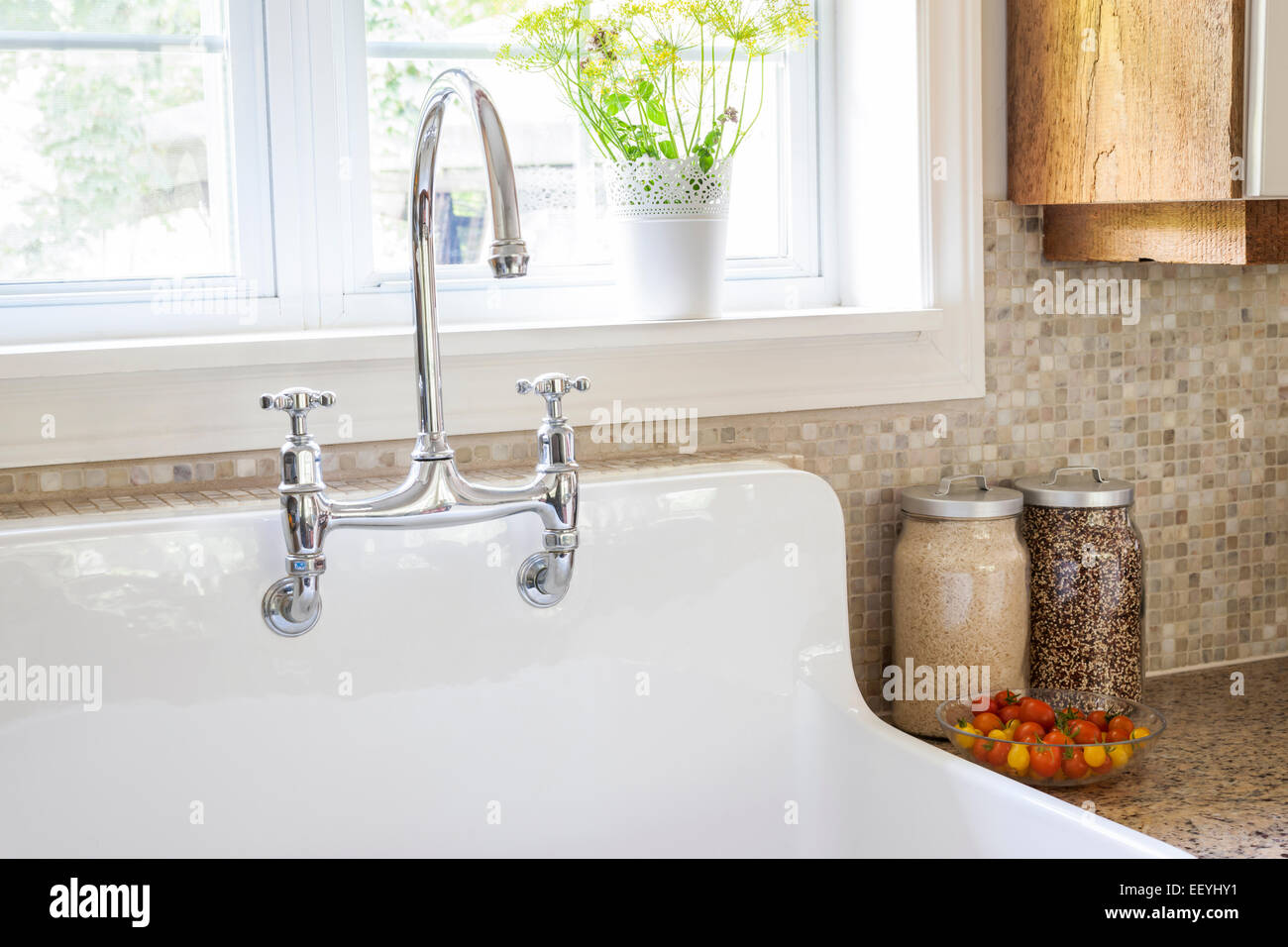 https www alamy com stock photo rustic white porcelain kitchen sink with curved faucet and tile backsplash 78053445 html