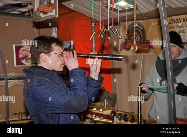 A Visitor Tries Out A Telescope From A Stall At The World Famous Greenwich Market