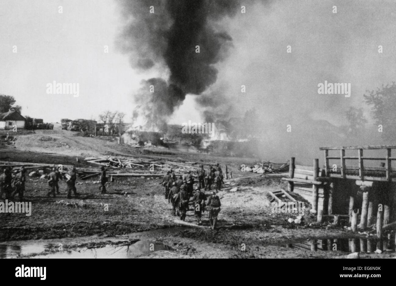 German Infantry Advancing On A Burning Village In The