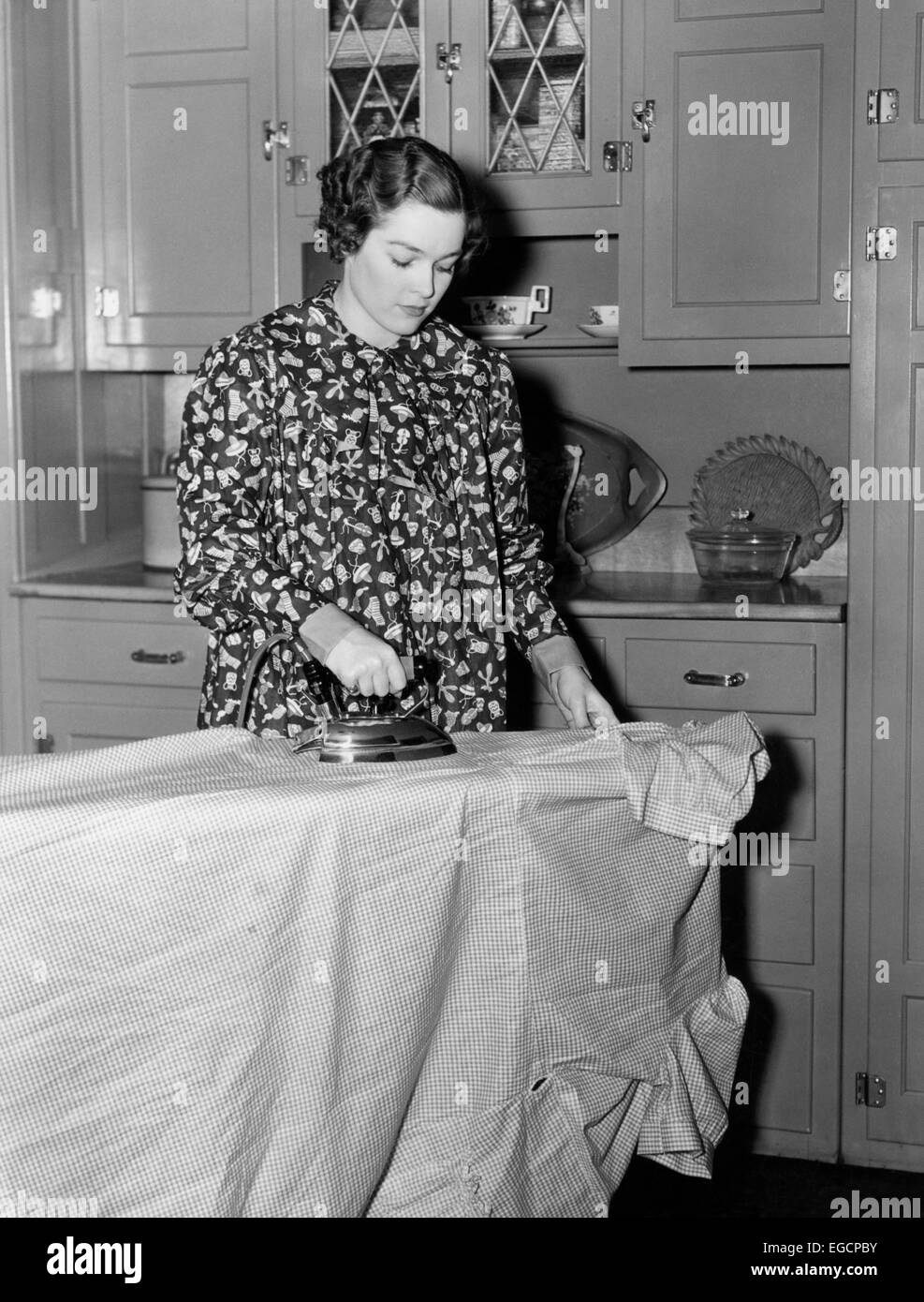 1930s 1940s Woman Wearing Printed Smock Apron Standing