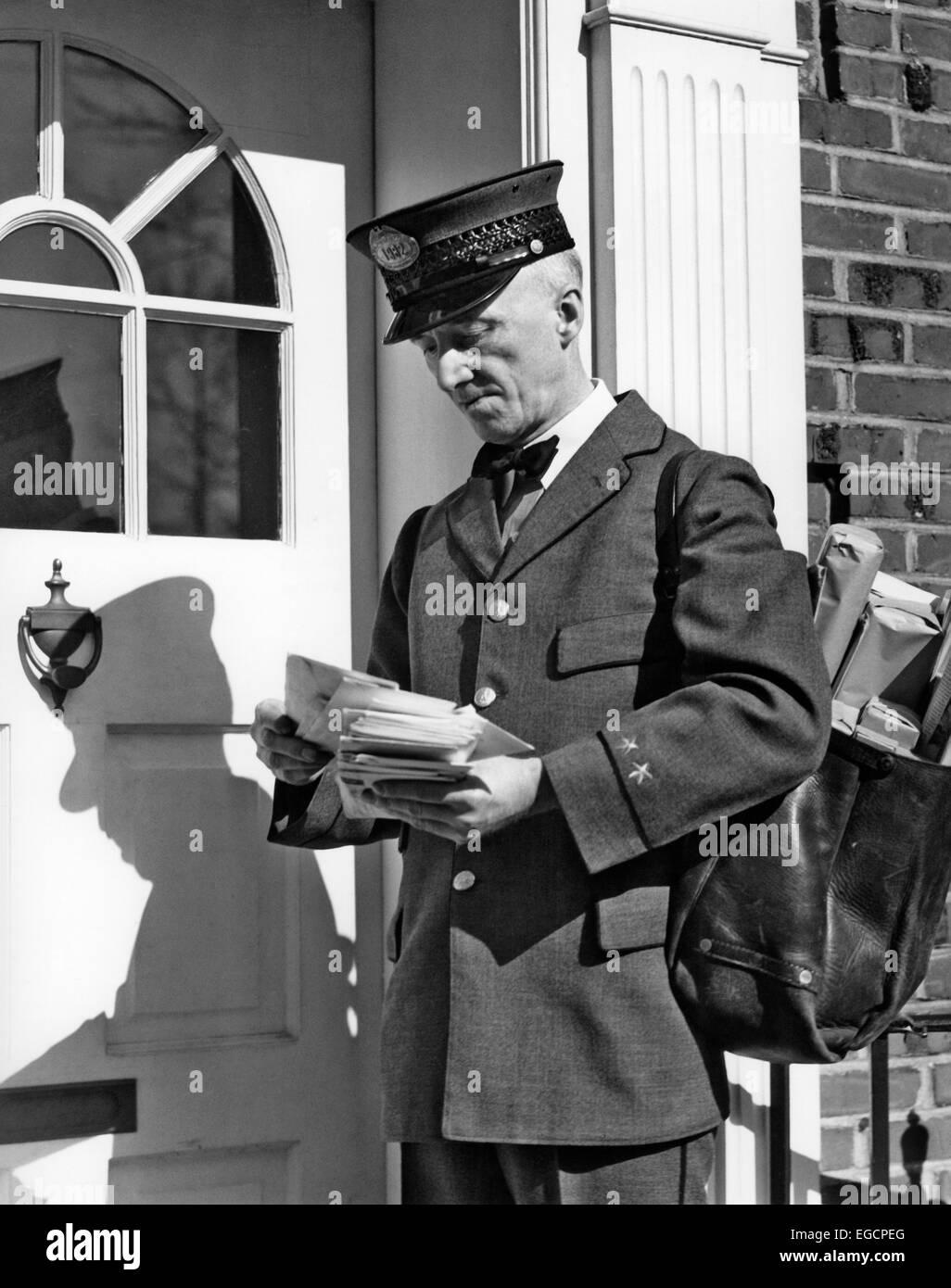 S S Postal Service Uniformed Mailman Delivering