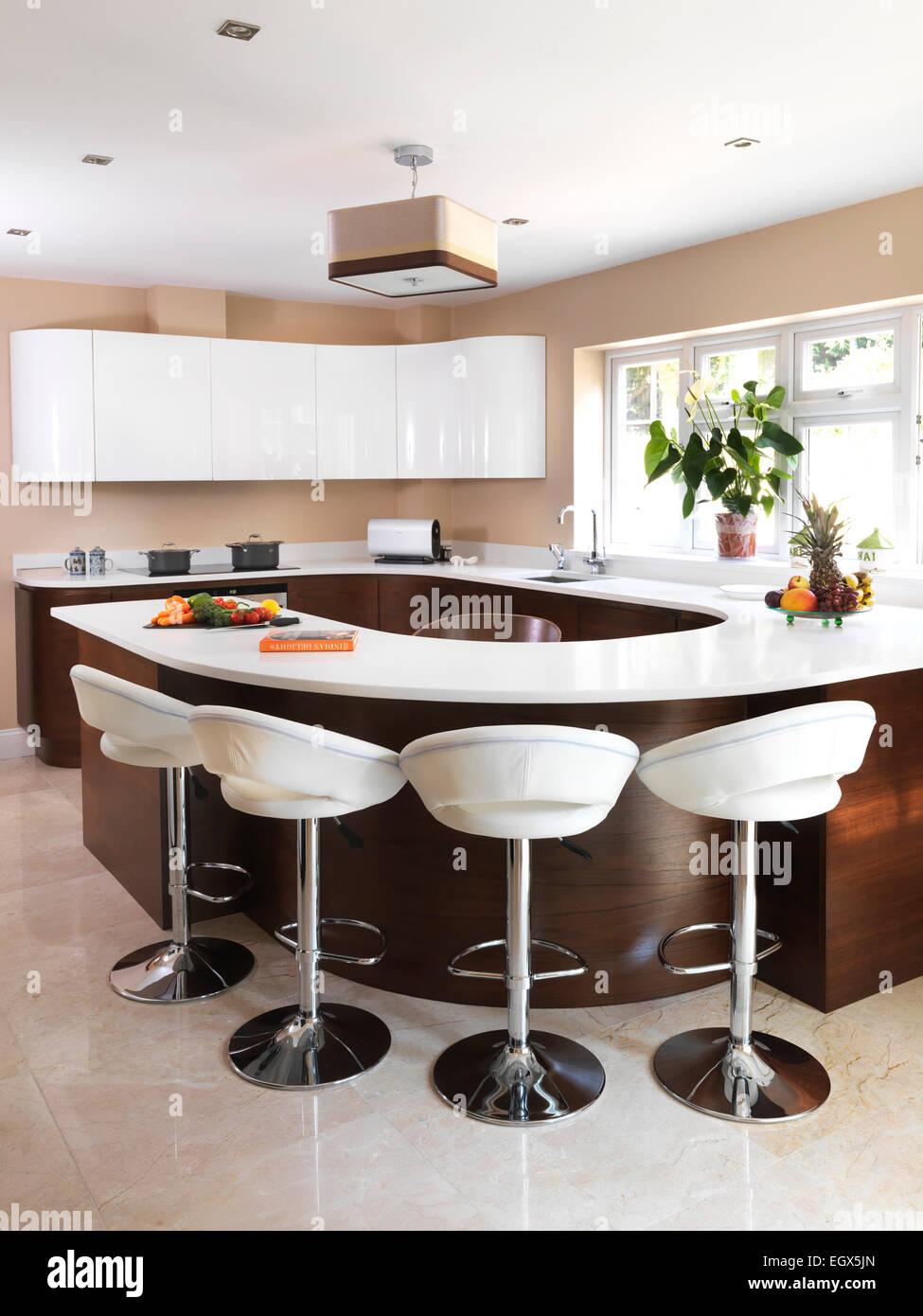 Bar Stools At Breakfast Bar In Modern Kitchen Uk Home Stock Photo Alamy