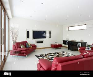 Modern Living Room With Red Leather Sofas And Built In