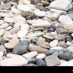 Rounded Pebbles In Shades Of Grey Blue White Cream And Orange Stock Photo Alamy