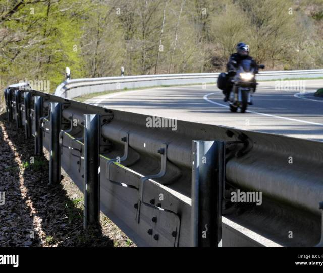 Motorcycle Rider On Country Road With Crash Barrier Protection Germany Europe Stock Image