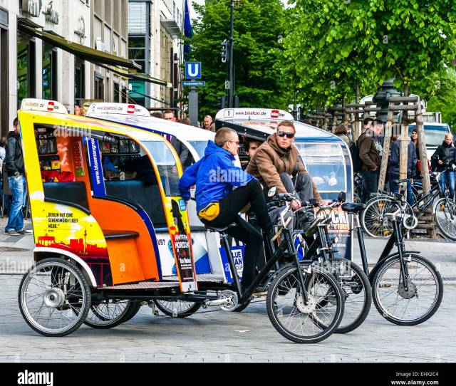 A Cluster Of Bicycle Taxis Waits For Tourists To Escort Through Berlin Germany