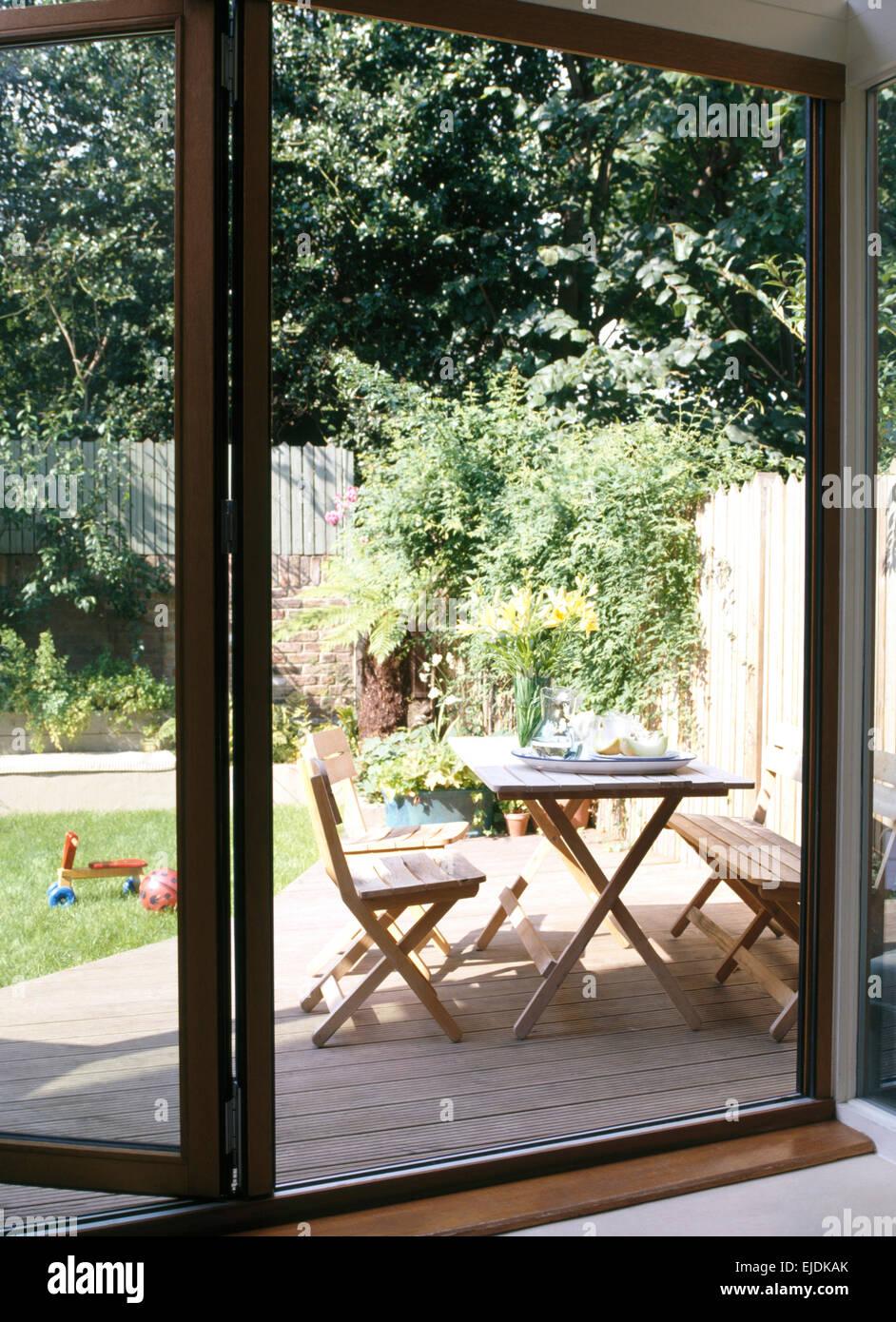 https www alamy com stock photo view through open bi fold glass patio doors of wooden furniture on 80205851 html