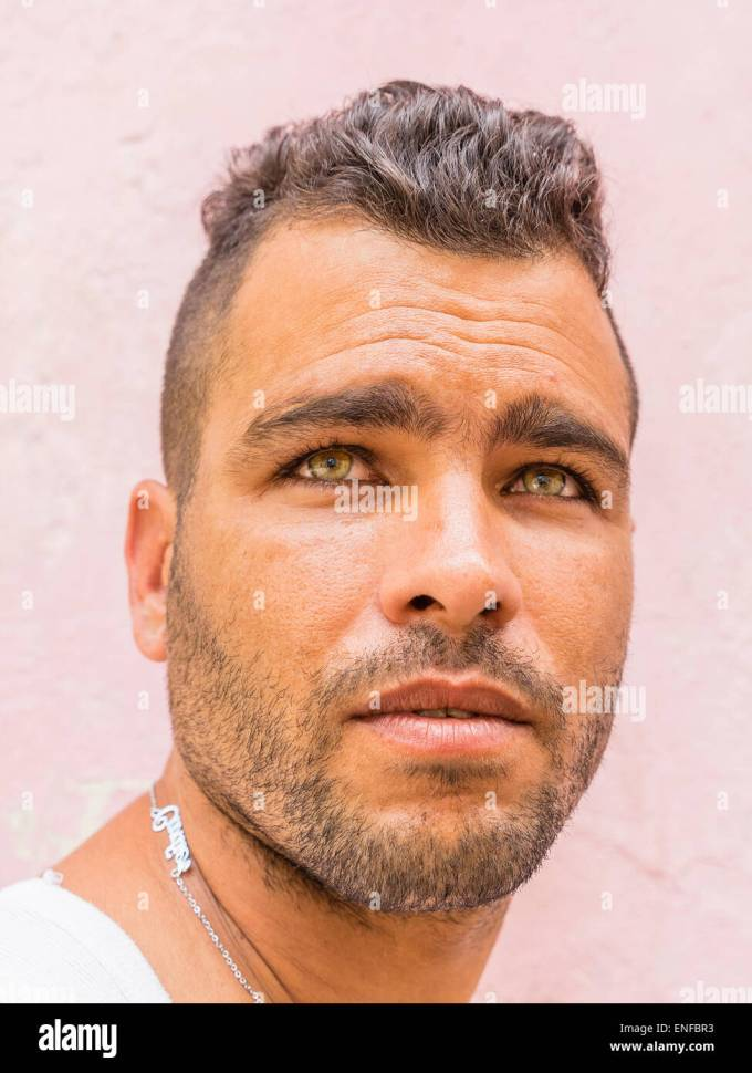 a close-up of the face of a 20-29 year old hispanic cuban