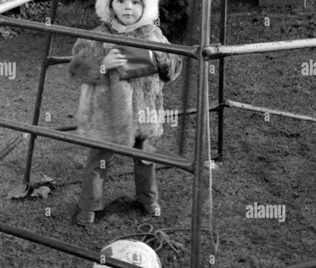 Young Girl Playing Inside A Climbing Frame In A Garden In England In The 1970s