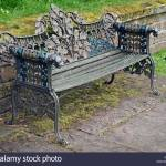 Ornate Painted Cast Metal And Wood Garden Bench Seat With Oak Leaf Stock Photo Alamy