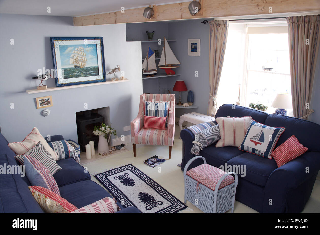 Blue Sofas With Striped Cushions In Coastal Cottage Sitting