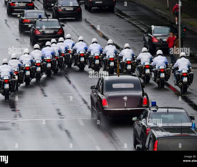 Berlin Germany Rd June  Police Officers Escort The Bentley Car Carrying British Queen Elizabeth Ii And Her Husband Prince Philip In Berlin