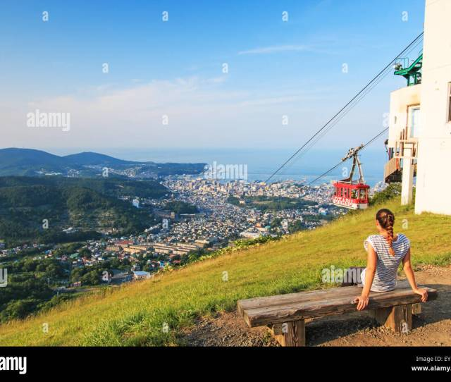 Otaru Japan July 112015 Girl Watching The Cityscape Of Otaru In Hokkaido With A Cableway On Her Right