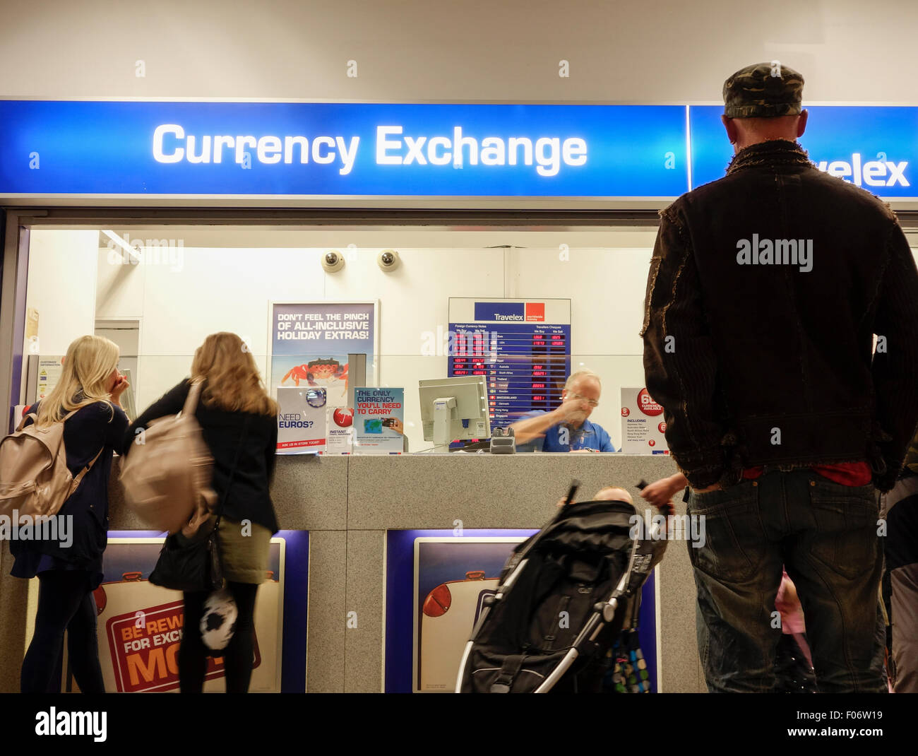 People At Travelex Currency Exchange Office In UK Airport
