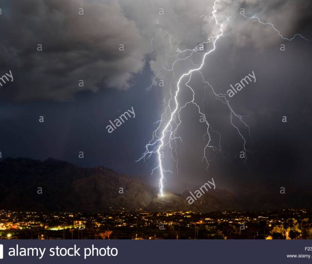A Huge Lightning Bolt Strikes The Side Of The Santa Catalina Mountains Near Ventana Canyon Summer
