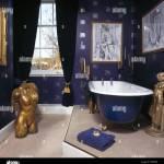 Large Gilt Torso Statue In Dark Blue Bathroom With Roll Top Bath On Stock Photo Alamy