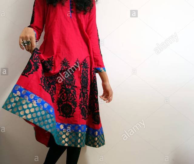 An Indian Girl In Red Black And Blue Dress With Traditional Design