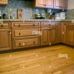 Kitchen With Oak Cabinets Wood Floor And Granite Countertops And Stock Photo Alamy