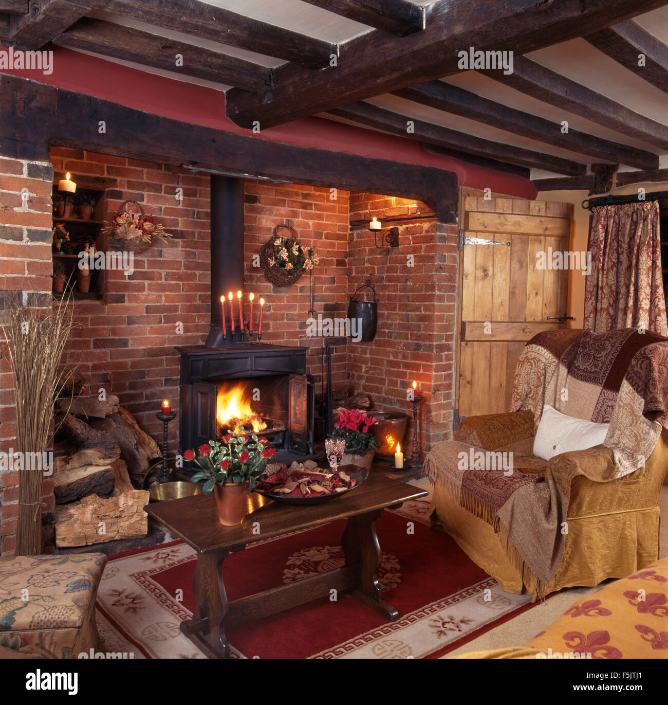 Wood Burning Stove In Inglenook Fireplace In A Beamed