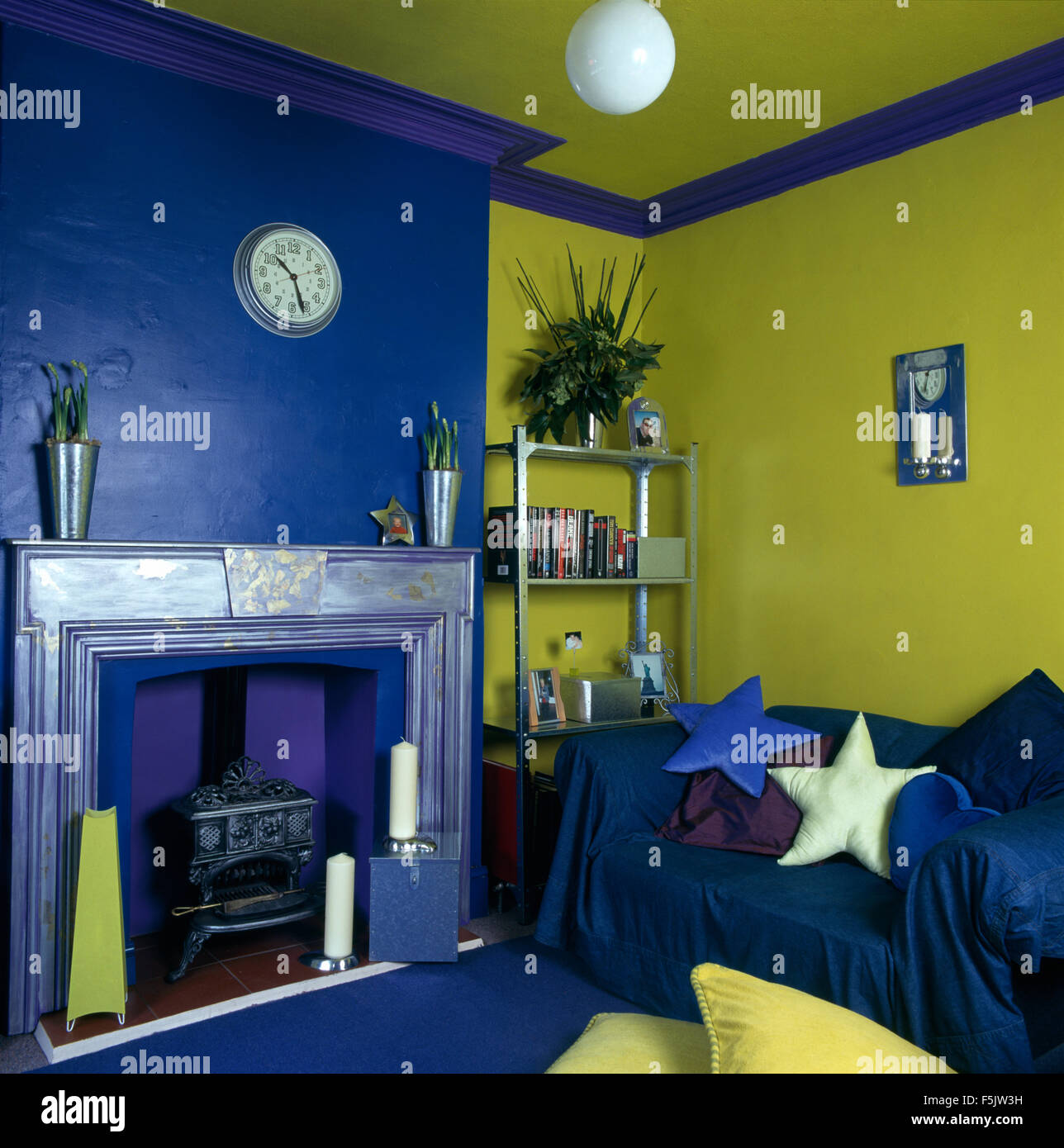 Star Shaped Cushions And Blue Throw On Sofa In Lime Green And Bright Stock Photo Alamy