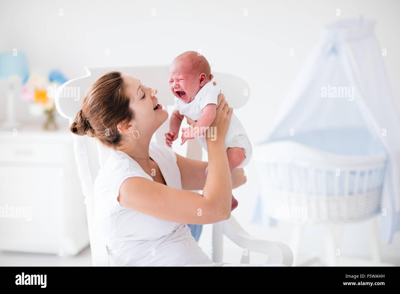 Young Mother Hugging Her Newborn Child Mom Nursing Baby