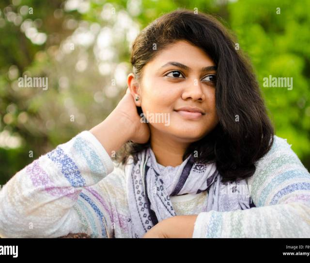 Portrait Of A Chubby Round Face Indian Teenage Girl Looking Away Staring Into The Distance