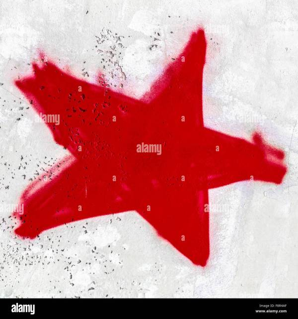 A red star painted on the wall with spray paint Stock ...